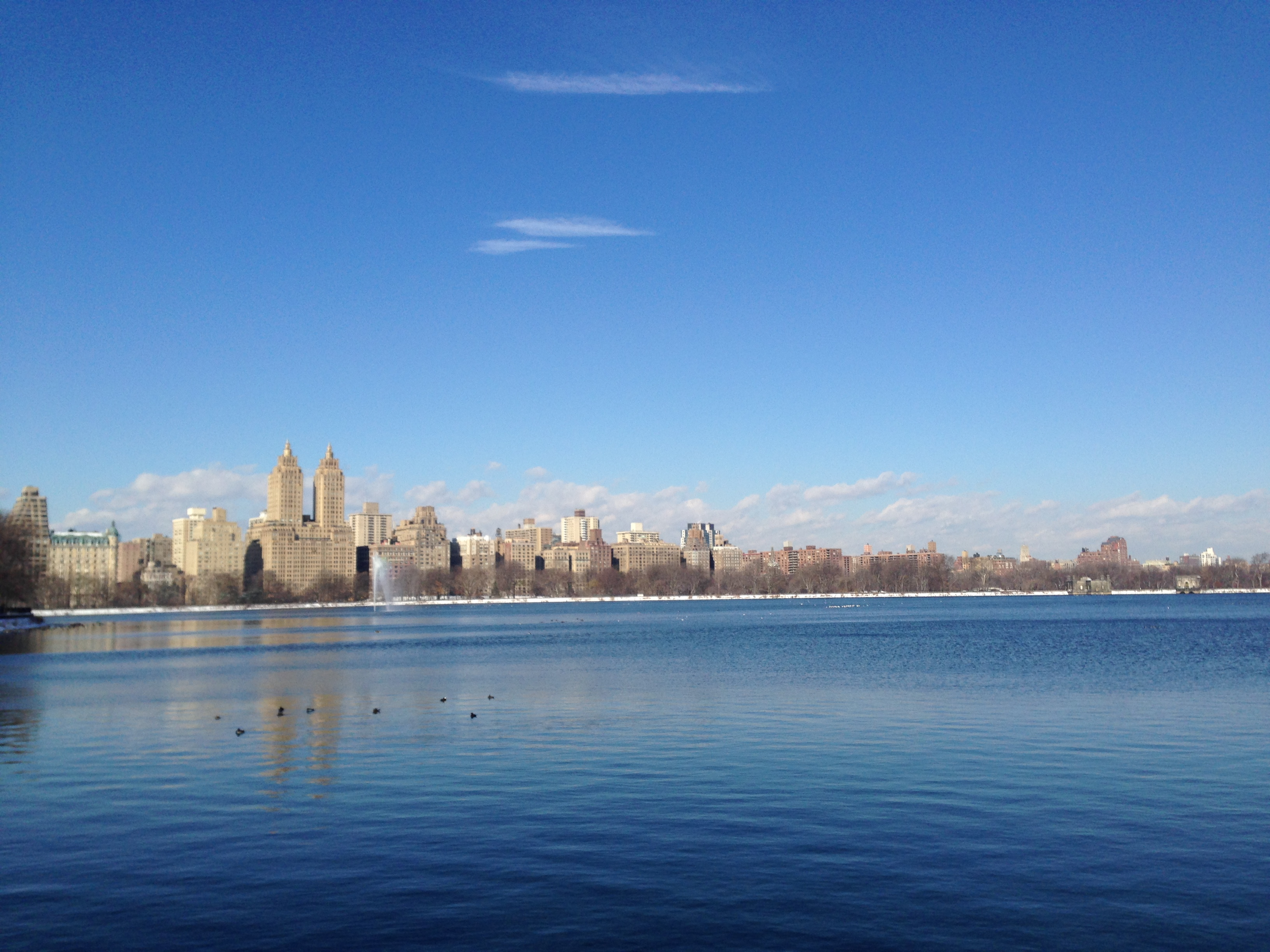 The Dakota and Central Park West across Central Park Lake